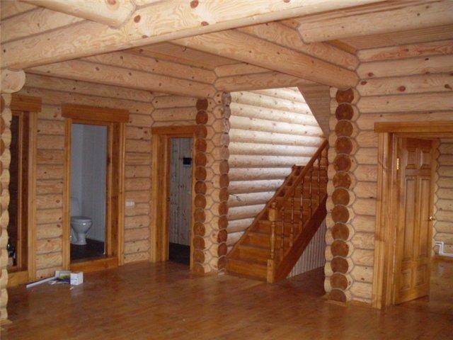 Как обрабатывать дом из оцилиндрованного бруса?